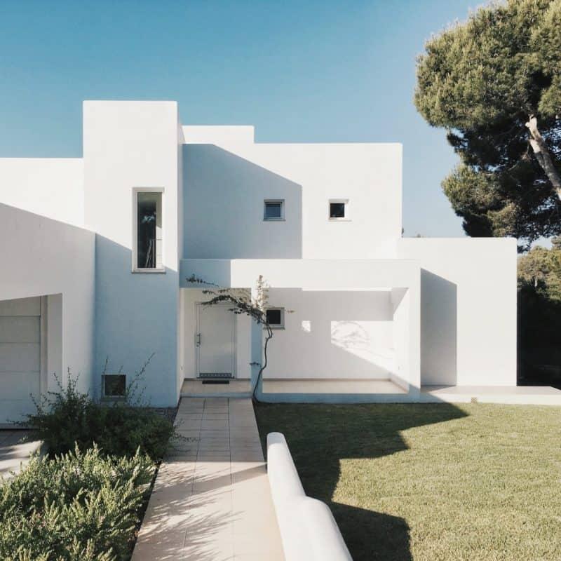 white 2 storey house near trees 1115804